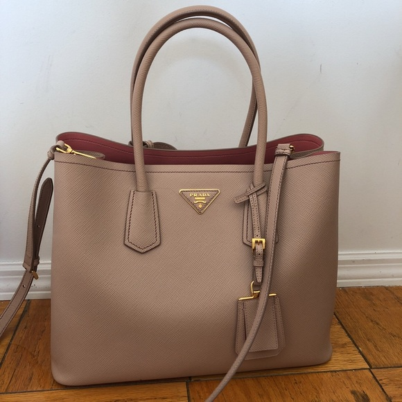 aea1abcdbd5596 M_5b3528793e0caa10aaf18b28. Other Bags you may like. Prada. Prada. $480 $0.  Authentic Prada Ivory White Leather Handbag